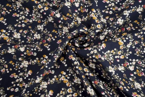 Viskose Blütenzweige auf dunkelblau
