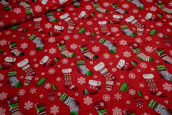 Baumwollstoff Weihnachten bunte Strümpfe und Schneeflocken auf rot